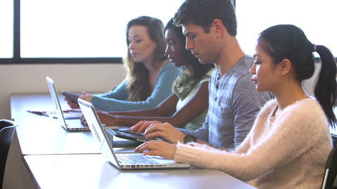 University Students Using Digital Tablet And Lapto Footage
