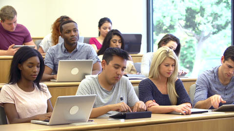Students Using Laptops And Digital Tablets In Lect Footage