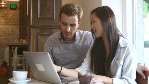 Couple Using Laptop Computer In Café Restaurant Footage