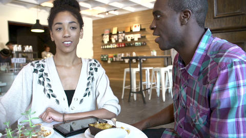 Couple Using Digital Tablet In Café Restaurant Footage
