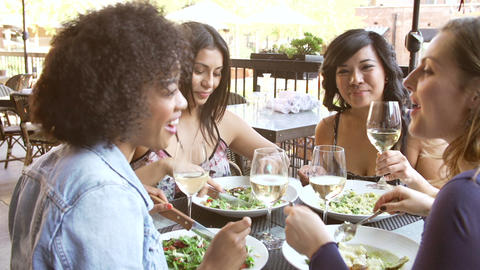 Group Of Female Friends Enjoying Meal At Outdoor R Footage