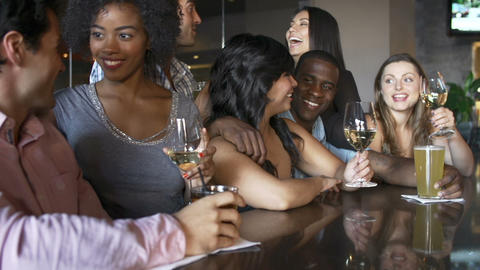 Group Of Friends Enjoying Drink At Bar Together Footage