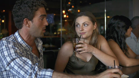 Couple Enjoying Drink At Bar Together Footage