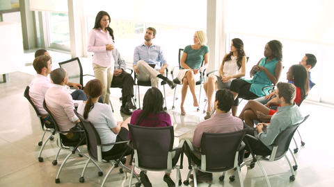 Support Group Meeting With People Seated In Circle stock footage