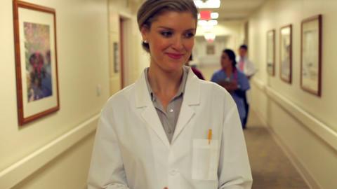 Doctor Walking Along Hospital Corridor Using Digit Footage