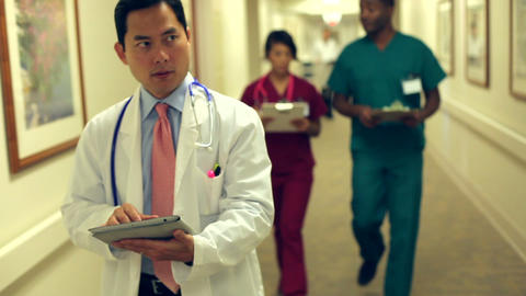 Medical Staff Working At Busy Nurses Station stock footage