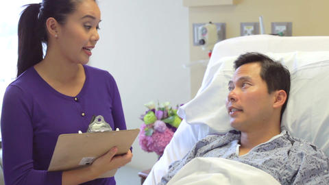 Medical Team Meeting Around Male Patient In Hospit Footage