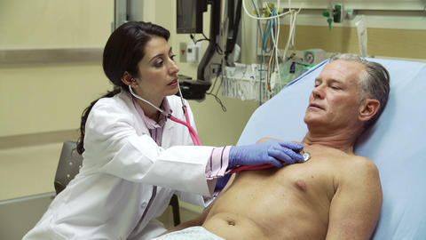 Doctor Examining Mature Male Patient In Hospital B Live Action