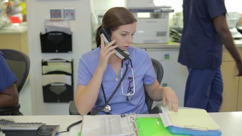 Medical Staff Working At Nurses Station Footage