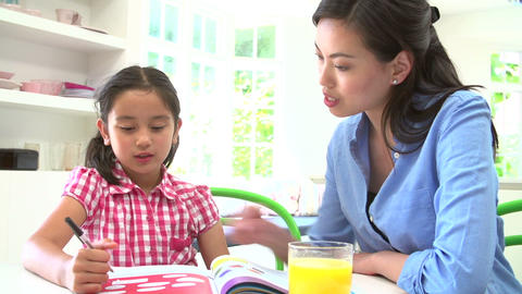 Asian Mother Helping Daughter With Homework Live Action