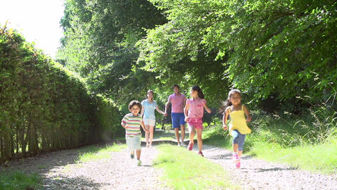 Asian Family Enjoying Walk In Countryside Footage