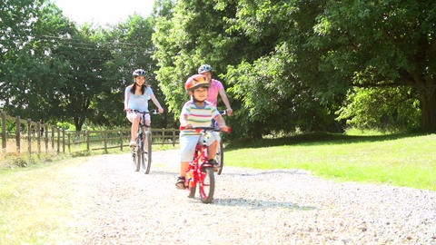 Asian Family On Cycle Ride In Countryside Footage