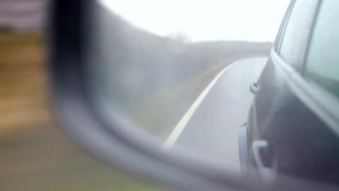 Rainy Car Journey Through Viewed Wing Mirror Footage