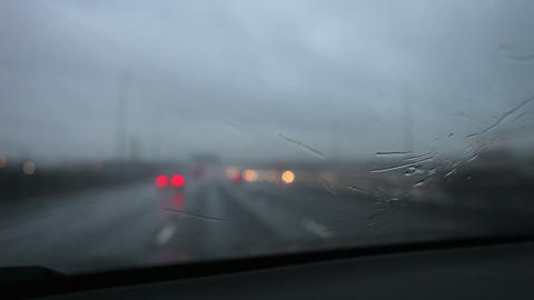 Rainy Car Journey On Motorway Viewed Through Winds Footage