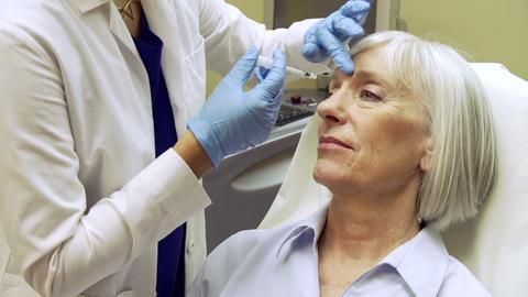 Woman Having Botox Treatment At Beauty Clinic Footage