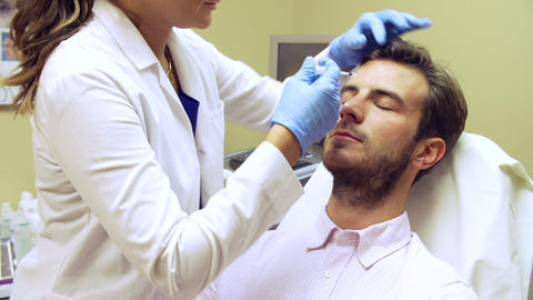 Man Having Botox Treatment At Beauty Clinic stock footage