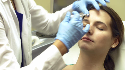 Woman Having Botox Treatment At Beauty Clinic Footage