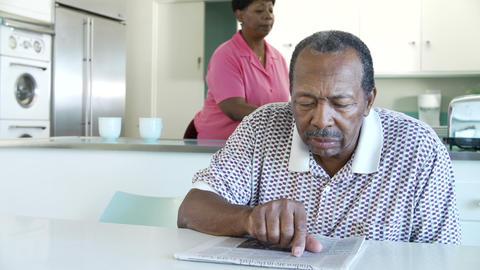 Senior Couple Having Breakfast As Husband Reads Ne Footage