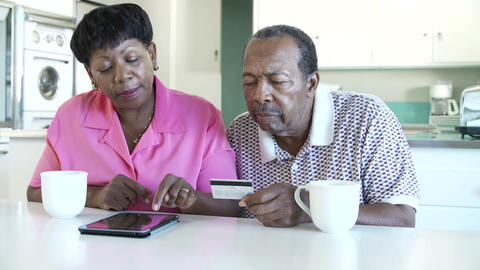 Senior Couple Booking Vacation Online Using Digita Footage
