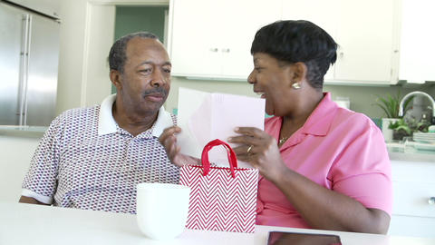 Senior Man Giving Wife Birthday Gift And Card Footage