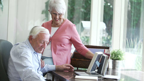 Senior Couple Looking At Picture In Frame And Phot stock footage