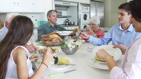 Multi-Generation Family Sitting Around Table Eatin Footage