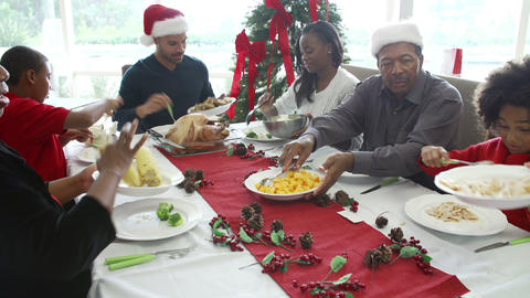 Multi-Generation Family Enjoying Christmas Meal To Footage
