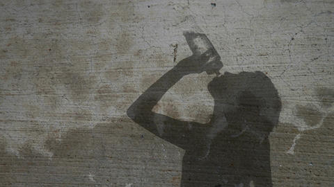 Silhouette Woman Drinking from Waterbottle Footage