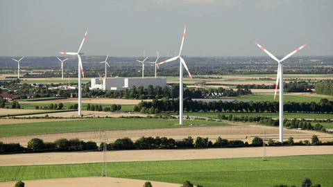 Rotating wind turbines in flat landscape Footage