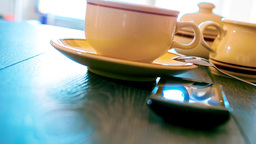 ringing phone on the table with coffee Footage