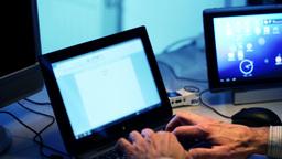 Hacker typing program on a laptop keyboard Footage