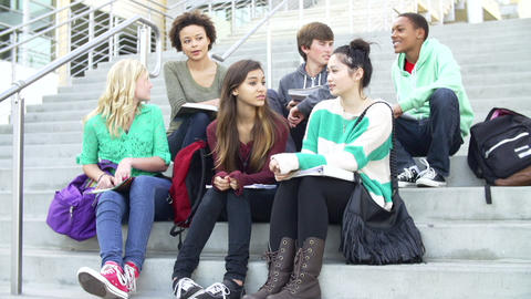 Group Of High School Students Sitting Outside Buil Footage