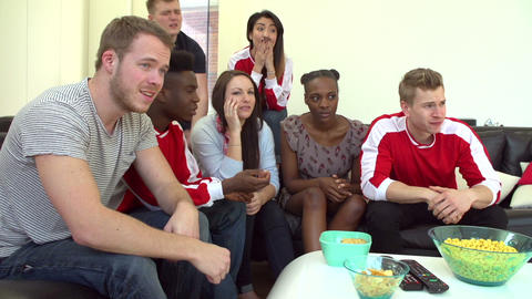 Disappointed Sports Fans Watching TV At Home In Sl Footage