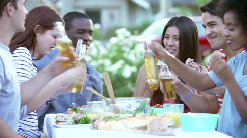 Group Of Friends Enjoying Outdoor Meal Together Footage
