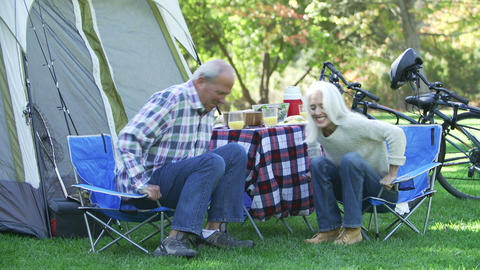 Senior Couple On Camping Holiday Setting Off On Cy Footage