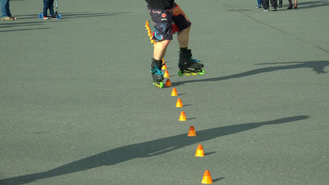 Skating on roller skates between cones. The snake. Footage