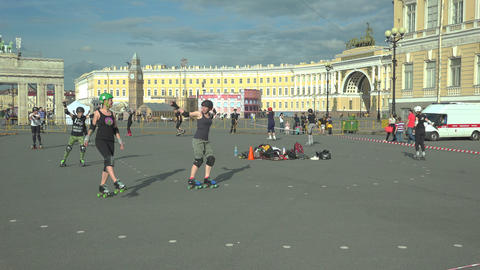 Athletes on roller skates train on Palace square.  Footage