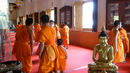 Thailand monks ending a prayers session before a f Footage