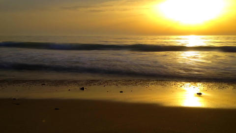Sunset timelapse with waves crash on shore Footage