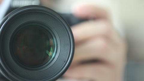 Photographer Operating A Camera stock footage