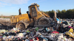 Garbage dump. Bulldozer at garbage landfill. 6 Live Action