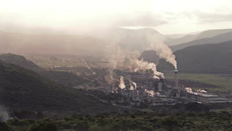 Smokey Industrial Plant Wide Shot stock footage
