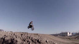 Racer Jumping On A Motorcycle stock footage