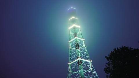 Television tower at night decorated with fires. St Footage
