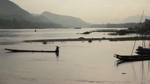 Fisherman On Mekong River Laos 2 1 stock footage
