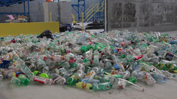 Recycling - plastic bottles at recycling center 4 Live Action