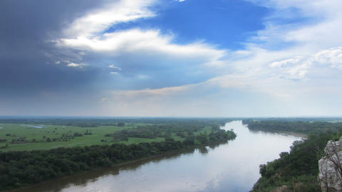 timelapse landscape with river and rain on horizon Footage