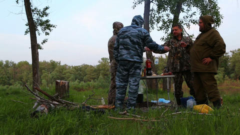 russian fishermen drink vodka around campfire at n Footage