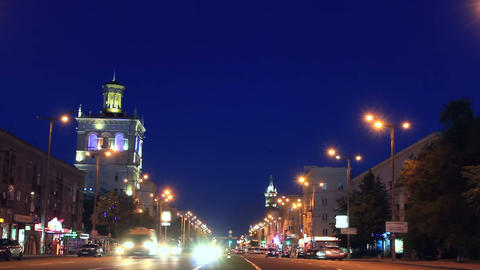 Central avenue of Zaporizhzhya at evening with fla Footage
