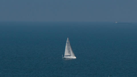 Sailing boat in open blue sea, top view Footage